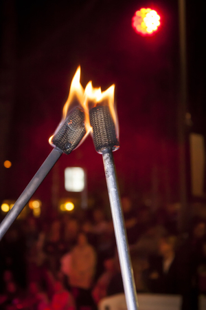 Torches burned with flames used by jugglers in a show Stock Photo