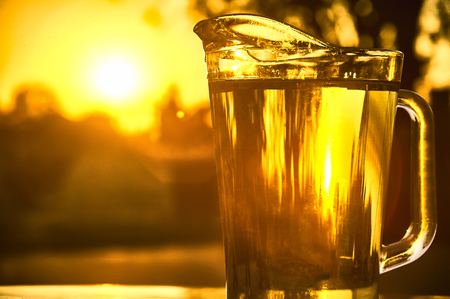 Pitcher of cool water shooting against the light on a beautiful sunset.