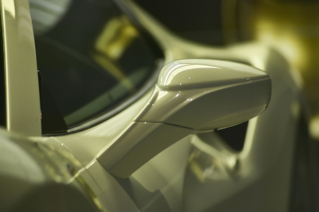 Detail of a rear-view mirror from the hemodynamic design of a sports car