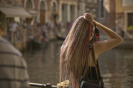 Shoulder girl photographing a glimpse of venice