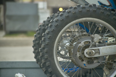 Wheel of a cross (or enduro) motorcycle with unpaved tires for better traction on difficult terrain.