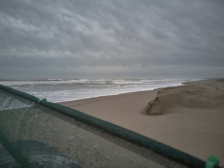 View of a beach in Northern Italy, (Rosolina Mare) during a cloudy day.
