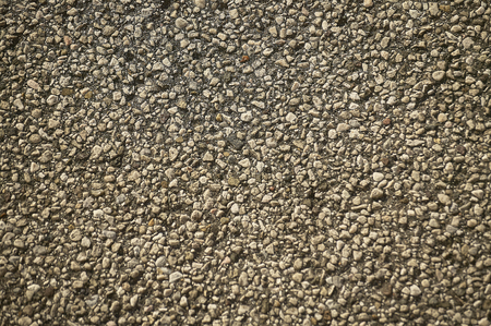 Texture with very high level of detail of a portion of asphalt with great magnification.