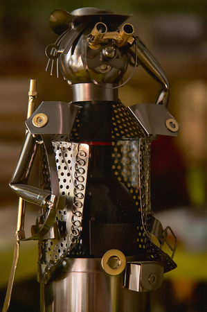 Small handmade tin man used as a wine bottle holder to decorate the table for dinner.