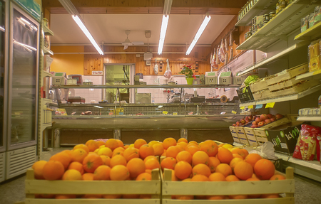 View of the inside of a small supermarket with the butchery counter opposite the point of recovery. Stok Fotoğraf - 96290736