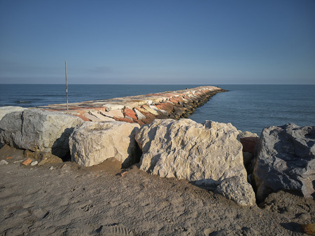Wide angle view of a cliff on the sea at Rosolina Mare In Italy