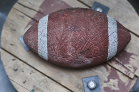 Detail of a vintage football ball with all the signs of time and wear.