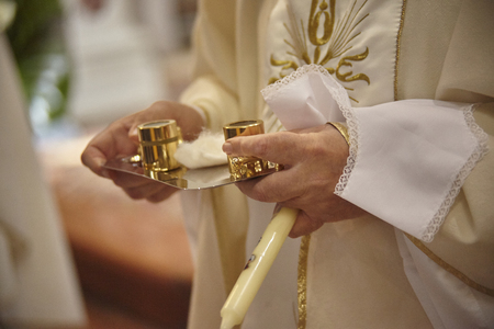 Containers of chromium scare oils and catechumens used by the priest during the rite of Christian and Catholic baptism.