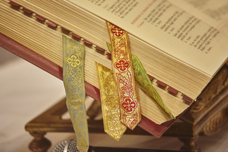 Missal with various bookmarks used as a book for the readings during the celebrations of the Masses in the Catholic Relicion.