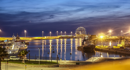 The port of Civitavecchia in Italy during the night illuminated by artificial light.
