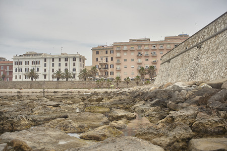 Coastal view of the city of Civitavecchia in Italy with the drainages and the pier: a typically Mediterranean landscape.