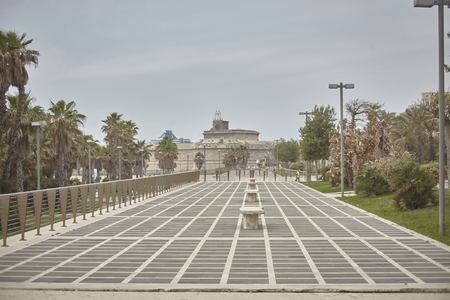 View of a historic walkway in Civitavecchia in Italy with a particular floor made with crossed lines that give a particular optical effect. 版權商用圖片