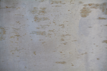 Texture of a metal surface with evident signs of corrosion damage.