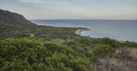 Top view of the Punta Molentis beach in the south of Sardinia: Typical Mediterranean meditaerranean cove of the place immersed in a green and overgrown natural vegetation.