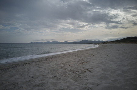 View of Piscina Rei Beach in the south of Sardinia completely free from tourists during sunset