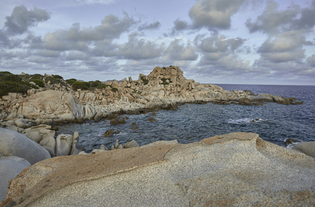 Detail of the southern coastline of Sardinia, precisely in the locality of Punta Molentis: a coastline with particular shapes given by the granite rocks that compose it shaped by the sea.
