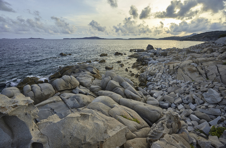 Beautiful southern coast of Sardinia made of stones and granite rocks that form a natural conformation of absolute scenic impact.