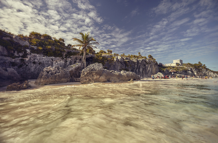 View of the beach of the Tulum archaeological site in Mexico during sunset.