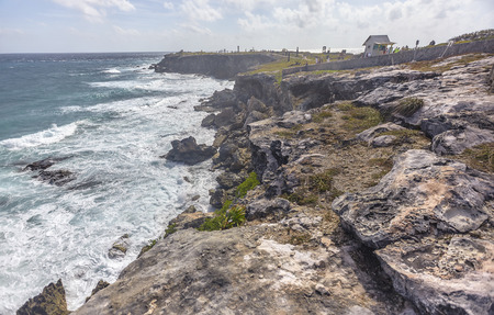 Seascape of rocky coastline with cliff overlooking the sea at Isla Mujeres in Mexico