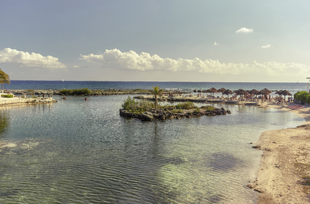 View of Puerto Aventuras beach in mexico, during sunset on a beautiful summer day.