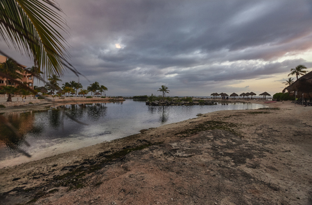 View from the bottom of the Puerto Aventuras beach in mexico during the dusk