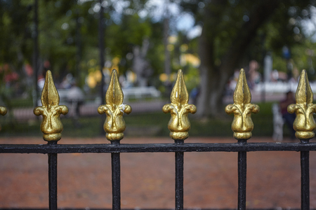 Detail of the golden spikes of a gate surrounding the park of the Piazza di Valladolid in Mexico
