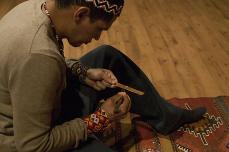 Detail of the shaman's hands as he prepares the Kambò: a substance extracted from the glands of a South American frog for its shamanic ceremony