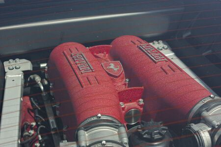 Detail of the engine, in particular the intake system, of a Ferrari, the sports car par excellence. 報道画像