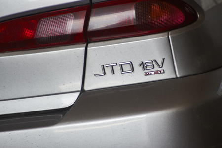 Detail with the JTD plate that indicates a Diesel 3 euro car, the category that affects traffic blockage in Italy Banco de Imagens