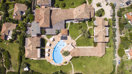 View of some houses with a pool in Costa Rei in southern Sardinia taken from above with a drone Banque d'images