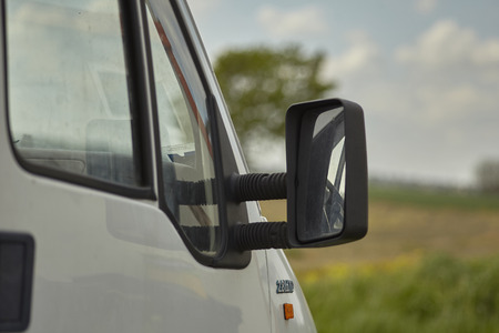 Detail of the rearview mirror of a van