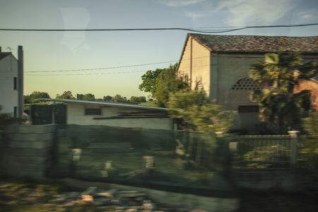 View of the houses and the view from the window Along the road in motion