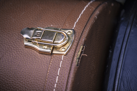 Detail of a Closing a vintage metal suitcase Banco de Imagens