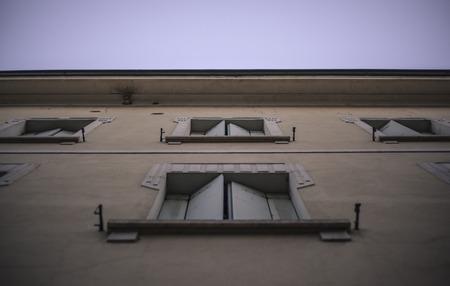 Windows of a facade of a historic building in Rovigo seen from below 版權商用圖片