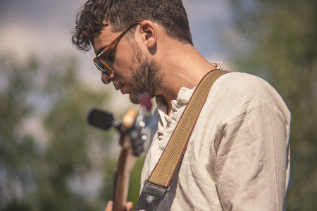 Close up profile of a rock musician during a concert Standard-Bild