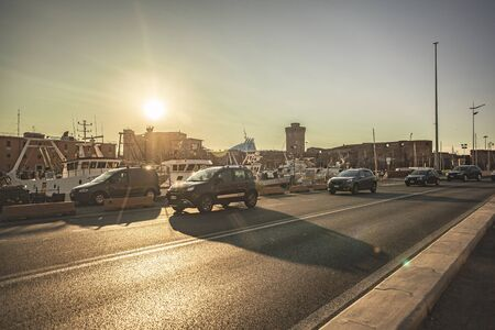 Traffic in the street of the Port of Livorno during sunset