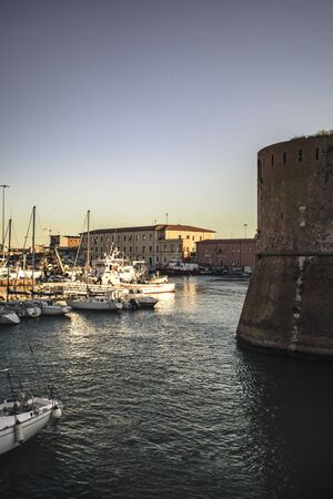 Vertical Panoramic view of the port of Livorno with moored boats Editorial