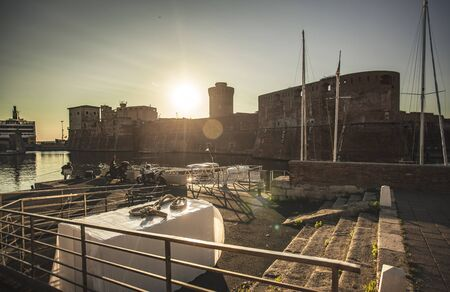 Panoramic view of the port of Livorno with boats moored during sunset