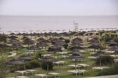 Straw umbrellas in a Sicilian Beach