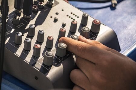 Two-channel audio mixer used in music production Stock Photo