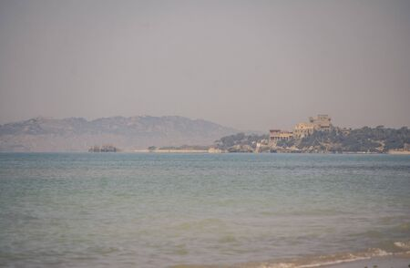 View of the beach of Marina di Butera that overlooks the Sicilian town of Gela Stock Photo