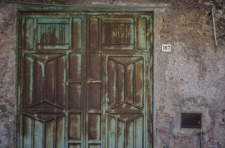 Old rusty metal door of a house in Sicily Banco de Imagens