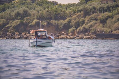 Fishboat in the sea in Sicily 免版税图像