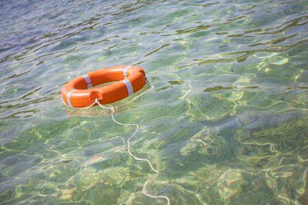 Life buoy on transparent sea for safe