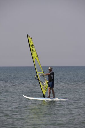 Windsurfing in the blue sea of Sardinia Imagens