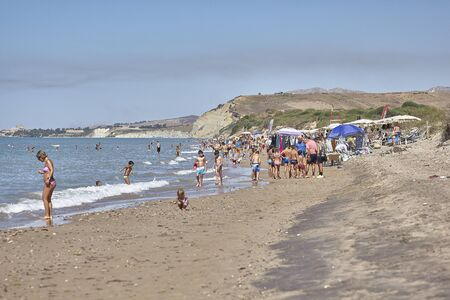 Bathers by the sea in Sicily