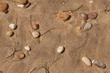 Pebbles on Sand in a beach in Sicily Stock Photo