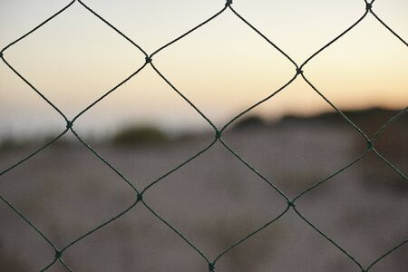 Wire mesh in a fence 스톡 콘텐츠