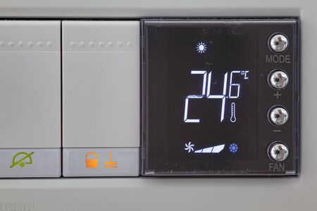 Digital thermostat used to regulate the temperature of the heating system Banco de Imagens
