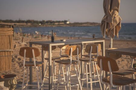 Small tables in the beach bar in Sicily (Modica) Stok Fotoğraf - 131597758